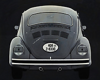 A B&W Volkswagen Beetle seen from the back.  With this painting of the back of the legendary Volkswagen Beetle you get a nice detail. This Volkswagen Beetle drives away from you. -<br />