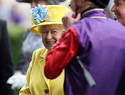 Queen Elizabeth II meets James Doyle, jockey of her horse Fabricate running in the Wolferton Stakes during day one of Royal Ascot at Ascot Racecourse.