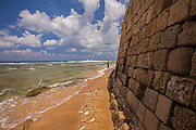Fisherman in the Mediterranean Sea at the foot of the Acre fortress. Acre, Israel