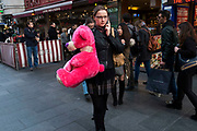 Street scene in Leicester Square of a girl carrying a pink teddy bear which she has just won in London, England, United Kingdom. This remains one of London's tourism hot spots with entertainers and shop and space to hang out.  (photo by Mike Kemp/In Pictures via Getty Images)