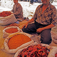 Uygur men sell chili peppers in a bazaar in the village of Muq near Kashgar (Kashi), a city on the ancient Silk Road in Xinjiang, China.