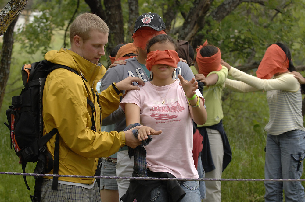Granite Shoals, TX April 24. 2007:  Eighth grade Hispanic  students are blinfolded and led into a rope maze in order to test their group problem solving ability at The Outdoor School on Lake LBJ, Texas. The students are from a  Brownsville, TX public charter school.  ©Bob Daemmrich /