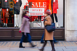 """London, December 20th 2014. Tens of thousands of shoppers descend on central London to scoop up pre-Christmas bargains as retailers offer discount incentives on """"Panic Saturday"""". PICTURED: Shoppers are attracted by strong discounts as high street retailers compete for their pounds."""