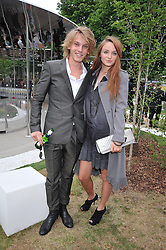 Actor JAMIE CAMPBELL BOWER and ZOE GRAHAM at the annual Serpentine Gallery Summer Party sponsored by Canvas TV  the new global arts TV network, held at the Serpentine Gallery, Kensington Gardens, London on 9th July 2009.