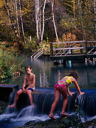 Children playing in the thermal water of Liard River Hot Springs Provincial Park, northern British Columbia, Canada.