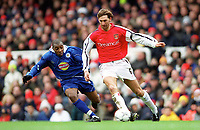 Tony Adams (Arsenal) Andy Impey (Leicester City). Arsenal 6:1 Leicester City, FA Carling Premiership, 26/12/2000. Credit Colorsport / Stuart MacFarlane.