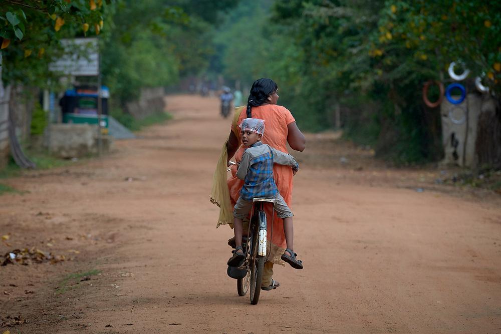A mother and her son ride a bike in Parantan, Kilinochchi, Sri Lanka.