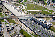 Nederland, Utrecht, Utrecht, 09-04-2014; Rijksweg A2 en de noordelijke ingang van de Leidsche Rijntunnel, een landtunnel die de verkeersoverlast, luchtvervuiling en geluidsoverlast voor Utrecht en de Vinexwijk Leidsche Rijn moet verminderen. Direct na de spoorlijn is het betonnen dak van de tunnel zichtbaar, hier moet een park op komen.<br /> Roadway A2 and the southern entrance to the tunnel Leidsche Rijn, a landtunnel built to decrease the nuisance of traffic noise and air pollution for the city of Utrecht and the suburb Leidsche Rijn . Right the Amsterdam-Rhine Canal and the city of Utrecht.<br /> luchtfoto (toeslag op standaard tarieven); aerial photo (additional fee required); copyright foto/photo Siebe Swart.