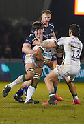 Sale Sharks flanker Ben Curry holds up London Irish's Blair Cowan during a Gallagher Premiership Rugby Union match won by Sharks 39-0, Friday, Mar. 6, 2020, in Eccles, United Kingdom. (Steve Flynn/Image of Sport)