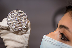 "© Licensed to London News Pictures. 19/03/2021. LONDON, UK. A staff member views a ""Diamond brooch, designed by The Earl Mountbatten"" (est. £4,000 - 6,000). Preview of the upcoming sale of property from the collection of the Patricia Knatchbull, 2nd Countess Mountbatten of Burma.  Over 350 lots spanning jewellery, furniture, paintings, sculpture, books, silver, ceramics & objets d'art are to be auctioned on 24 March at Sotheby's New Bond Street galleries.  Photo credit: Stephen Chung/LNP"