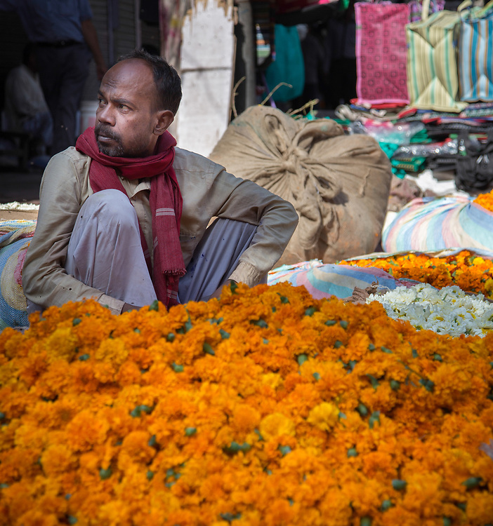 A flower seller in Old Town in New Delhi, India.
