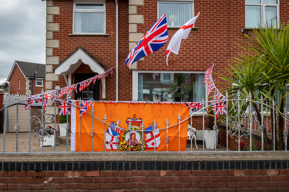 House decorated in preparation of the celebrations. Orange March, Belfast, NI, 2021