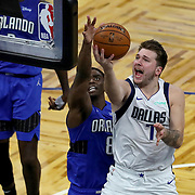 ORLANDO, FL - MARCH 01: Luka Doncic #77 of the Dallas Mavericks drives to the basket against Dwayne Bacon #8 of the Orlando Magic during the second half at Amway Center on March 1, 2021 in Orlando, Florida. NOTE TO USER: User expressly acknowledges and agrees that, by downloading and or using this photograph, User is consenting to the terms and conditions of the Getty Images License Agreement. (Photo by Alex Menendez/Getty Images)*** Local Caption *** Luka Doncic; Dwayne Bacon