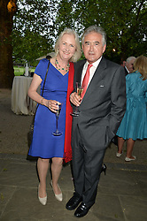ARTEMIS COOPER and ANTONY BEEVOR at a dinner hosted by Cartier in celebration of The Chelsea Flower Show held at The Hurligham Club, London on 19th May 2014.