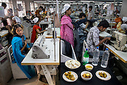 Ruma Akhter, a seamstress and one of over 6,000 employees at the Ananta Apparels company  in Dhaka, Bangladesh with her typical day's worth of food. (From the book What I Eat: Around the World in 80 Diets.)  MODEL RELEASED