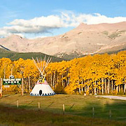 fall colors and teepee in east glacier park at travelers rest lodging