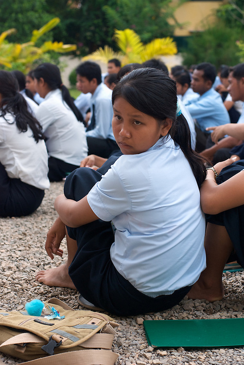 A student attends an afternoon assembly at the Provincial Teacher Training College in Siem Reap, Cambodia.  The school prepares young adults to teach locally, and is free for all who students who pass the admission test.