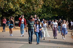 © Licensed to London News Pictures. 19/09/2020. London, UK. Groups of walkers enjoy the warm sunshine on the first weekend of the Rule of Six as Police patrol Hyde Park in London. Gatherings of over six people have now been banned by the Government after a spike in coronavirus cases. Prime Minister Boris Johnson announced yesterday that the UK was heading for a second wave with the North East alread