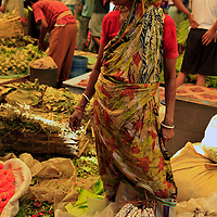 Asia, India, Calcutta. Woman in the flower market in Calcutta.