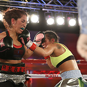 Noemi Bosques (L) throws a left hook against Nydia Feliciano during a Telemundo Boxeo boxing match at the A La Carte Pavilion on Friday,  March 13, 2015 in Tampa, Florida.  Feliciano won the bout by split decision. (AP Photo/Alex Menendez)