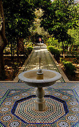 A tiled path through one of the gardens in the Bahia Palace in Marrakech, Morocco, North Africa<br /> <br /> <br /> (c) Andrew Wilson | Edinburgh Elite media