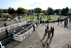 Jockeys make their way into the parade ring ahead of the Champions Day On Sky Sports Racing Nursery at Wolverhampton racecourse. Picture date: Monday October 11, 2021.