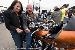 Fred Harwood and Mary Beth Grandner of Florida test a 2015 Road Glide at the busy Harley-Davidson display at Daytona International Speedway on the first day of Daytona Beach Bike Week 2015. FL, USA. Saturday, March 7, 2015.  Photography ©2015 Michael Lichter.
