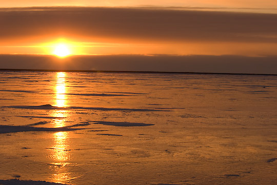 The sun sets over a fresh water lake near Cape Churchill, Manitoba.
