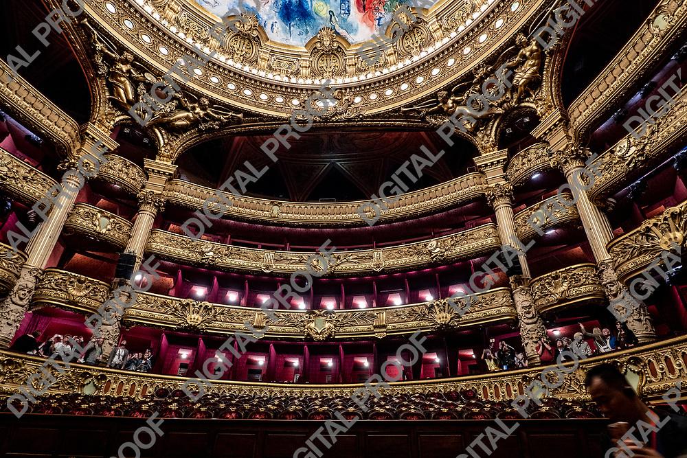 Palais Garnier - Paris Opera House - Tour groups Contemplate the suditorium interior architecture and decoration. Paris, France - May 14, 2019.