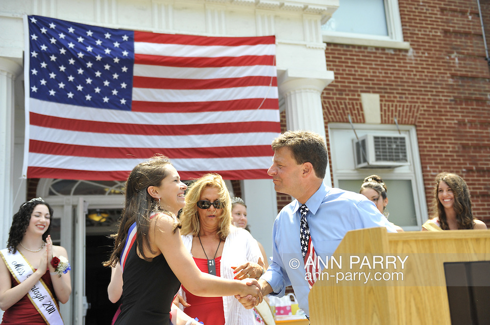 Miss Wantagh Pageant ceremony, a long-time Independence Day tradition on Long Island, is Wednesday, July 4, 2012, at Wantagh School, New York, USA. First runner up was Allysa Kelly, 2nd runner up was Paulina Renda, receiving congratulations from Legislator Dave Denenberg (Merrick - District 19).. Since 1956, the Miss Wantagh Pageant, which is not a beauty pageant, has crowned a high school student based mainly on academic excellence and community service.