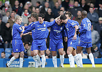 Photo: Lee Earle.<br /> Chelsea v Charlton Athletic. The Barclays Premiership. 22/01/2006. Chelsea players congratulate Eidur Gudjohnsen after his opening goal.