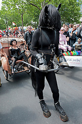 Woman being pulled by man dressed as horse  at Christopher Street Day Parade in Berlin Germany 2011