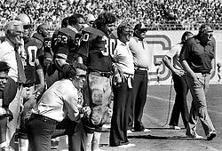 Oakland Raider sideline..(l-r)Team Doctor Small? actor Jim Garner, Pete Banazack, Gene Upshaw, Mark Van Eeghen, Ron Wolf, Tom Dahms,& John Madden...(1974 photo/Ron Riesterer)
