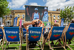 A general view of crowds watching Heather Watson play on a big screen on day one of the Wimbledon Championships on Wimbledon Broadway. Photo credit should read: Katie Collins/EMPICS