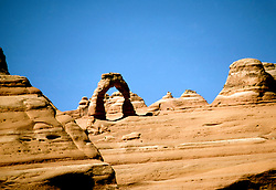 Utah: Arches National Park, Delicate Arch, utarch101     .Photo copyright Lee Foster, www.fostertravel.com, 510/549-2202,  lee@fostertravel.com