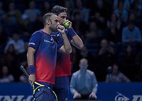 Tennis - 2019 Nitto ATP Finals at The O2 - Day Two<br /> <br /> Doubles Group Max Mirnyi: Juan Sebastien Cabal (COL) & Robert Farah (CAN) Vs. Pierre-Hugues Herbert (FRA) & Nicolas Mahut (FRA) <br /> <br /> Robert Farah (CAN) cofers with partner Juan Sebastien Cabal (COL) <br /> <br /> COLORSPORT/DANIEL BEARHAM