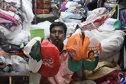 March 29, 2019 - Kolkata, West Bengal, India - Shop owner shows caps with symbol of various political party for sale ahead of Lok Sabha or general election 2019. (Credit Image: © Saikat Paul/Pacific Press via ZUMA Wire)