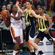 Galatasaray MP's Melisa CAN (L) and Fenerbahce's Nevriye YILMAZ (C), Angel McCOUGHTRY (R) during their EuroLeague Women Basketball League game 2 match Galatasaray MP between Fenerbahce at the Abdi Ipekci Arena in Istanbul at Turkey on Friday, February, 05, 2011. Photo TURKPIX