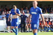 AFC Wimbledon manager Wally Downes shouting at players from sideline, hands to mouth during the EFL Sky Bet League 1 match between AFC Wimbledon and Shrewsbury Town at the Cherry Red Records Stadium, Kingston, England on 14 September 2019.