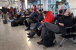 © Licensed to London News Pictures. 11/12/2017. London, UK. Passengers wait for flights at Heathrow's Terminal 5 after yesterday's snow continues to affect transport. British Airways had already cancelled 30 flights before 10am today. Photo credit: Peter Macdiarmid/LNP