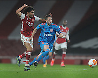 Football - 2020 / 201 UEFA Europa League - Round 16 - Second Leg - Arsenal vs Olympiakos - Emirates Stadium<br /> <br /> Kostas Fortounis of Olympiacos and Mohamed Elneny of Arsenal<br /> <br /> <br /> Credit : COLORSPORT/ANDREW COWIE