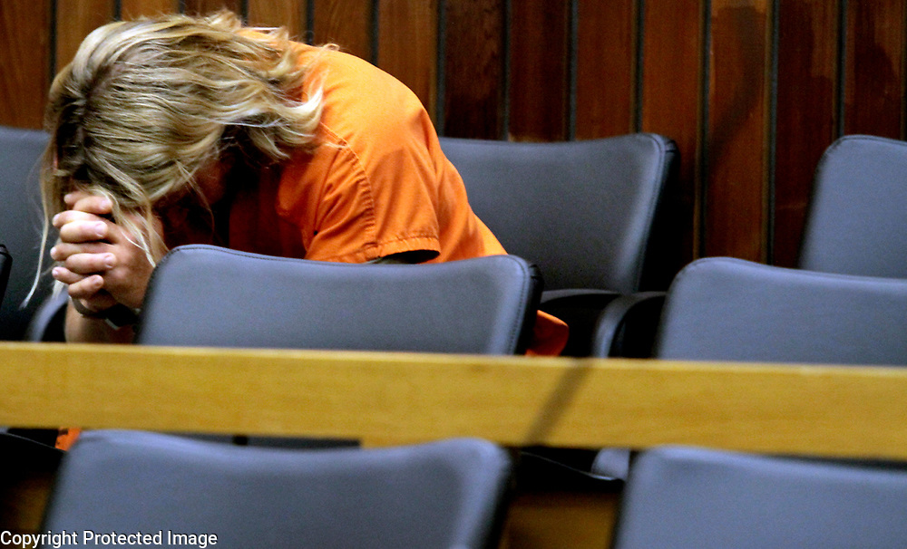 Surf school owner Dylan Greiner, 38, hangs his head as he waits to be arraigned in Santa Cruz County Superior Court in Santa Cruz, California on Wednesday August 21, 2013 on charges of lewd acts with a 14-year old girl, having an underage girl create pornography and secretly recording girls in his surf school dressing room.<br /> Greiner ended up pleading no contest to the charges and served two years in state Prison.<br /> Photo by Shmuel Thaler <br /> shmuel_thaler@yahoo.com www.shmuelthaler.com