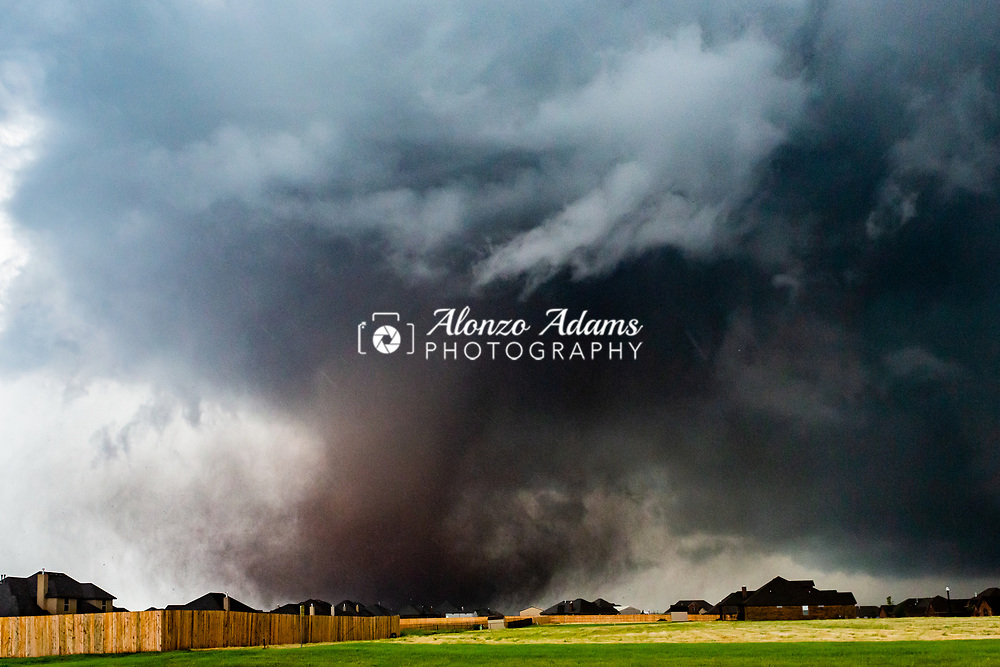 A tornado moves past homes in Moore, Okla. on Monday, May 20, 2013. Photo copyright © 2013 Alonzo J. Adams.