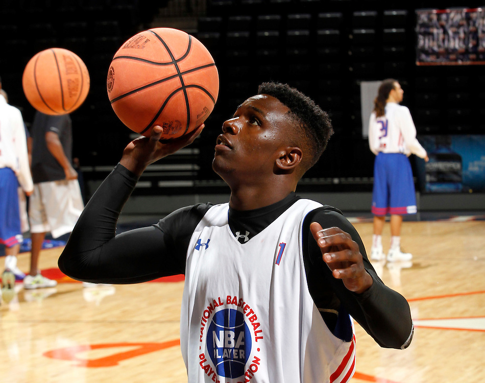 Aquille Carr participates in a basketball camp in Charlottesville, Va. (Photo/Andrew Shurtleff)