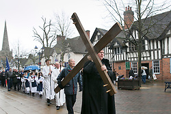 "3/4/2015. Solihull, West Midlands, UK. The Good Friday ""Walk of Witness"" taking place in Solihull. People of all faiths congrgate outside St Alphege Church and walk the short distance to Mell Square to hold a multi-faith prayer meeting. Pictured, The cross begins it's journey through Solihull. Photo credit : Dave Warren/LNP"