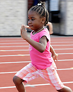 Tyierah Cook, 5, sprints during a race at the Twilight Track Series at Middletown High School on Tuesday, July 30, 2013.