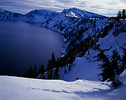 Winter view of Eagle Point and Garfield Peak, southern rim of Crater Lake, Crater Lake National Park, Oregon.