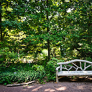 Park bench in a secluded spot at the US National Arboretum in Washington DC, a Department of Agriculture education and research reserve.