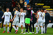 Peterborough players celebrate at the final whistle during the EFL Sky Bet League 1 match between Burton Albion and Peterborough United at the Pirelli Stadium, Burton upon Trent, England on 27 October 2018.