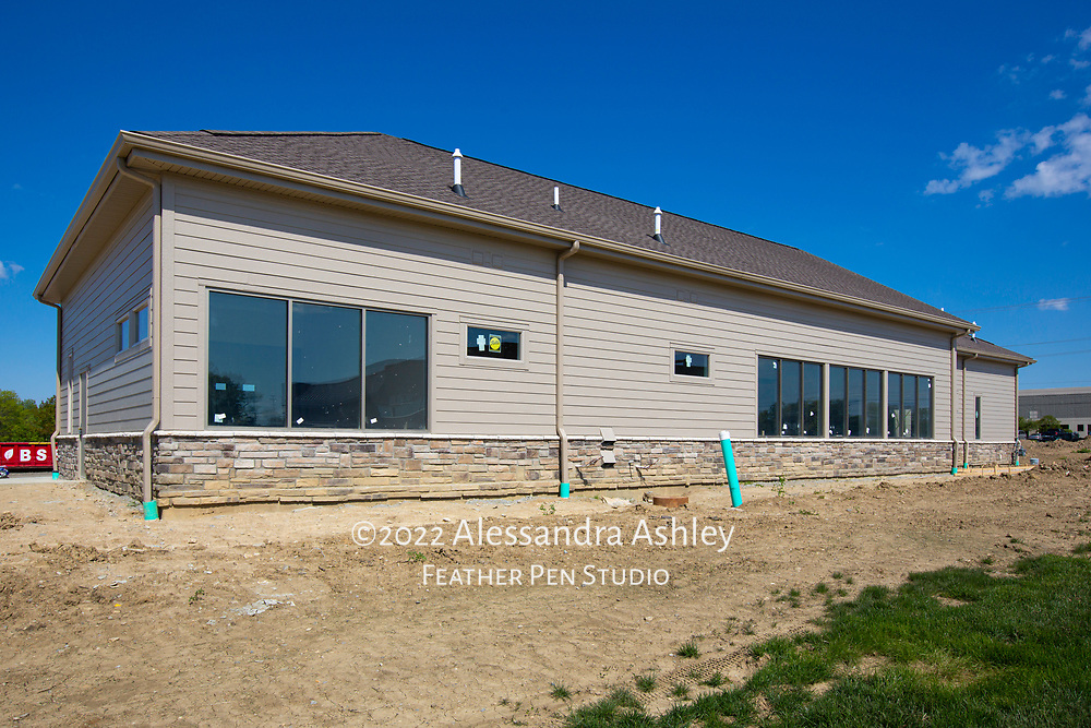 Exterior painting and stone work are complete at new physical therapy and wellness center building.